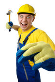 Young worker furiously hammering a nail — Stock Photo