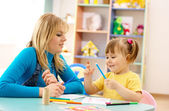 Teacher with child in preschool — Stockfoto