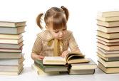 Cute little girl reading books — Stock Photo
