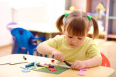 Cute child play with plasticine — Stockfoto