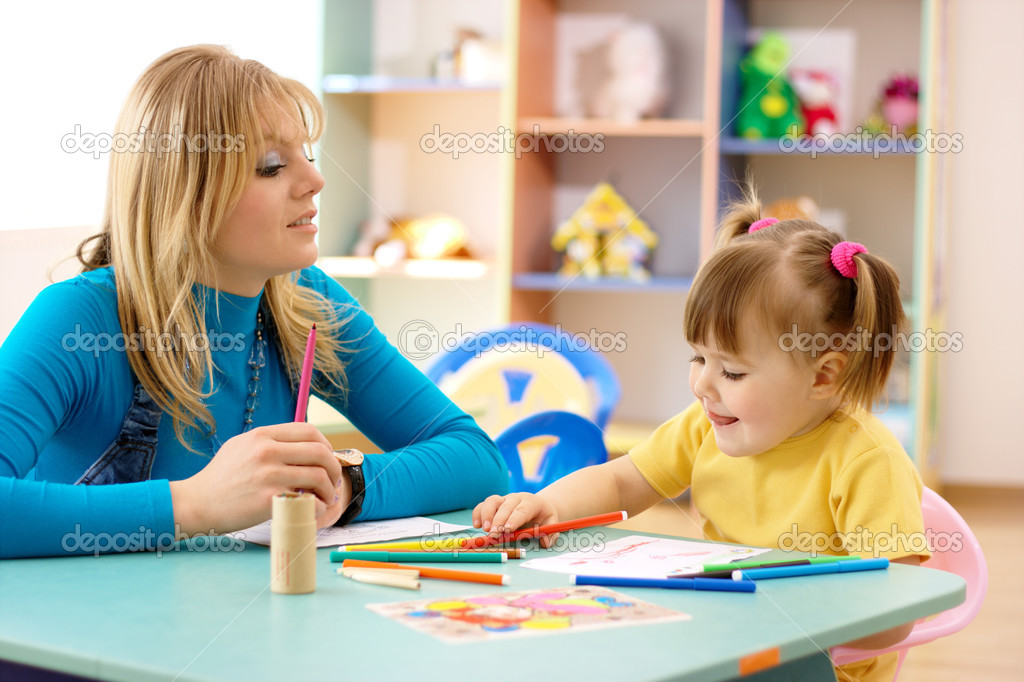 Teacher and child draw with markers in preschool  Stock Photo #3096587