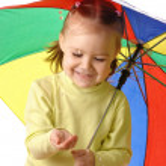 Cute child with umbrella — Stock Photo