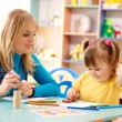 Teacher with child in preschool — Stock Photo #3179609
