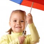 Cute child with colorful umbrella — Stock Photo #3179613
