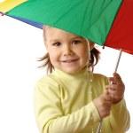 Child catching raindrops under umbrella — Stock Photo