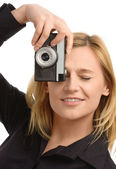 Woman taking a shot with photo camera — Stock Photo