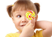 Little girl with lollipop — Stockfoto