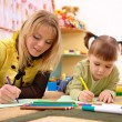 Teacher with child in preschool — Stock Photo #3375809