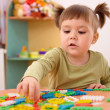 Little girl play with building bricks in preschool — Stock Photo #3375814