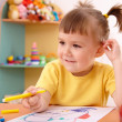 Little girl draw with felt-tip pen — Stock Photo #3375831