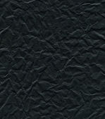 Wrinkly black paper texture — Stock Photo