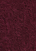 Carmine silky creased texture — Stock Photo