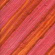 Pink and orange striped rug — Stock Photo