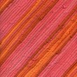 Pink and orange striped rug - Stock Photo