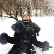 Happy girl playing with snow — Stock Photo