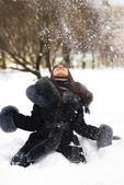 Happy girl playing with snow — Stockfoto