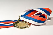 Isolated golden medal — Stock Photo