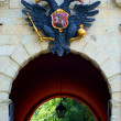 Fortress gates with emblem of Russia above — Stock Photo
