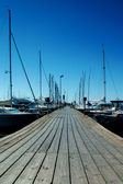 Wooden pier and yachts — Stock Photo