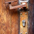 Door handle and rusty hardware - Stock Photo