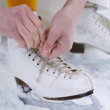 Putting on ice skates. — Stock Photo #3117507