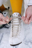 Putting on ice skates. — Stock Photo
