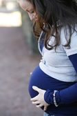 Young pregnant woman outdoors. — Stock Photo