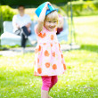 Little girl playing outdoors in summer — Stock Photo