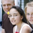 Stock Photo: Portrait of three happy adolescents toge