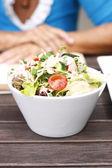 Delicious garden salad in a white bowl. — Stock Photo
