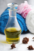 Massage oil and towels. — Stock Photo