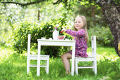 Smiling little girl at tea party. — Stock Photo