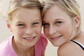 Two happy young sisters together outdoor — Stock Photo