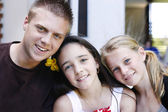 Portrait of three happy adolescents toge — Stock Photo