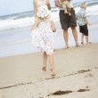 Family enjoying themselves at the beach. — Stock Photo