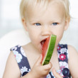 Cute little girl eating a watermelon. — Stock Photo #3146590