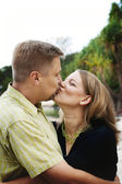 Portrait of a happy married couple kissi — Stock Photo