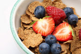 Bowl of breakfast cereal with fruit. — Stock Photo