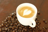 Piccolo latte with a heart shaped coffee — Stock Photo