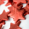 Red star shape Christmas decorations — Stock Photo