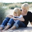 Mother and daughter at beach. — Stock Photo
