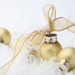 Gold Christmas bauble decorations with r — Stock Photo