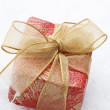 Christmas gift with red wrapping and dec — Stock Photo