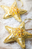 Golden star shape Christmas decorations — Stock Photo