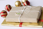 Two simply wrapped Christmas gifts with — Stock Photo