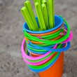 Stock Photo: Colourful buckets on sandy beach