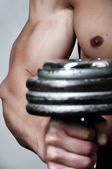 Muscle men's arm lifting weight — Foto Stock