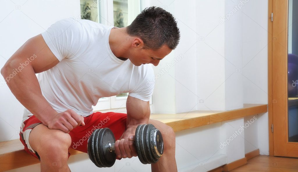 Powerful muscular man lifting weights — Stock Photo #3242215
