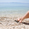 Woman legs on the beach — Stock Photo