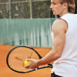 Royalty-Free Stock Photo: Young man playing tennis